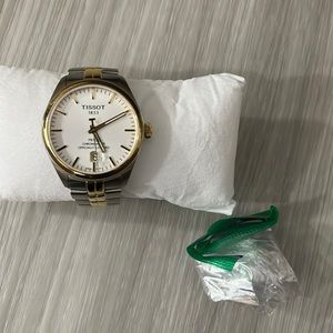 I have a tissot for sale two tone gold and stainless